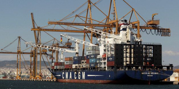A cargo ship is docked at the commercial terminal of the port of the northern city of Thessaloniki, Greece...