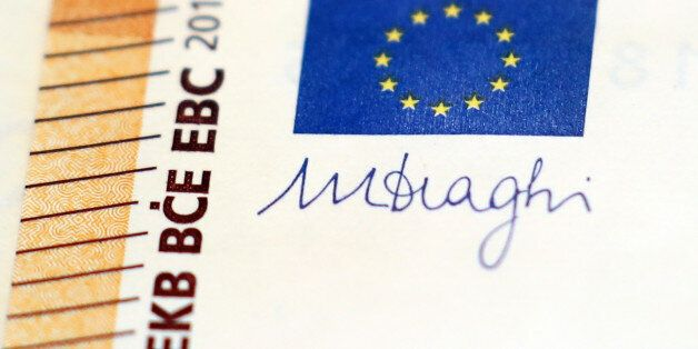 The signature of the President of the European Central Bank (ECB), Mario Draghi, is seen on the new 50...