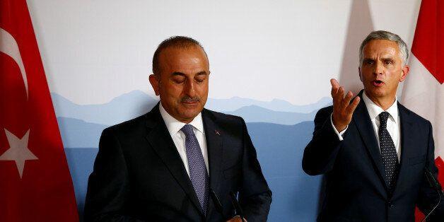 Swiss Foreign Minister Didier Burkhalter (R) and Turkish Foreign Minister Mevlut Cavusoglu attend a news...