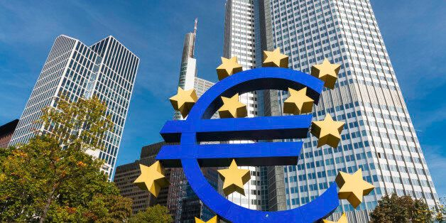The Eurotower of the European Central Bank -EZB- in Frankfurt with the Euro symbol and the twelve stars...