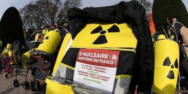 French and German anti-nuclear activists push strollers and banners reading 'nuclear : leave the fiasco...