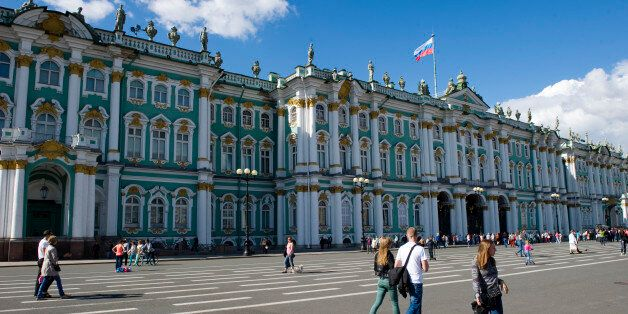 SAINT PETERSBURG, RUSSIA - JUNE 13: Pedestrians walk in front of the Hermitage museum on June 13, in...