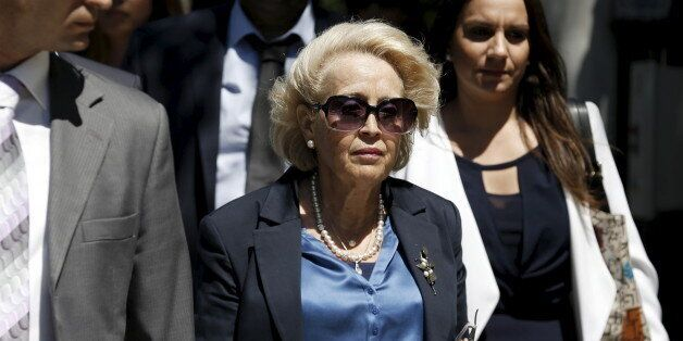 Greece's newly appointed caretaker Prime Minister Vassiliki Thanou (C) leaves her office at the Maximos...