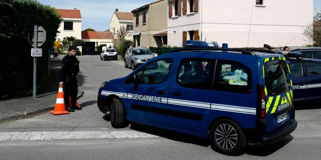 French gendarmes with their cars block the entrance to a street in Beaumont-les-Valence, southeastern...