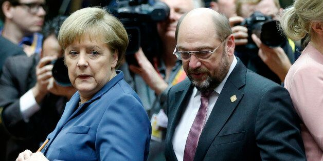 Germany's Chancellor Angela Merkel and European Parliament President Martin Schulz (R) attend a European...