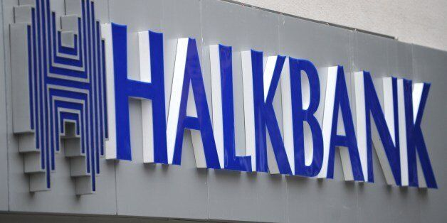 A view of a logo at the entrance of a Halkbank branch on Februrary 14, 2014, in Istanbul. Six suspects...