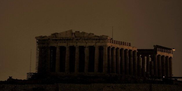 The ancient Parthenon Temple on top of the Acropolis hill is not floodlit as Greece participate in Earth...