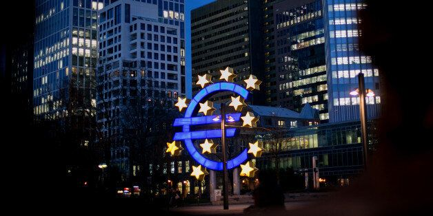 The euro sign sculpture stands illuminated near the former European Central Bank (ECB) headquarters at...