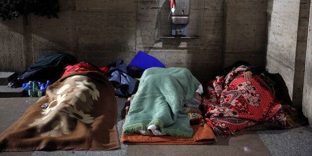 Homeless people sleep in passageway near St. Peter's square in Rome, Italy, January 11, 2017. REUTERS/Stefano