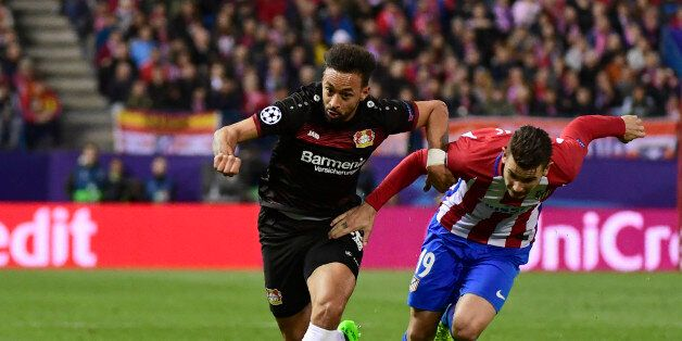 Leverkusen's midfielder Karim Bellarabi (L) vies with Atletico Madrid's French defender Lucas Hernadez...