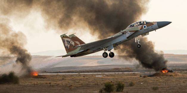 An Israeli F-15 fighter jet takes off during an air show at the graduation ceremony of Israeli air force...