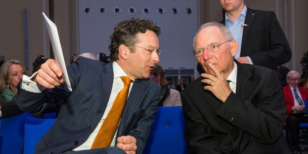 Jeroen Dijsselbloem, Dutch finance minister and head of the group of euro-area finance ministers, left,...