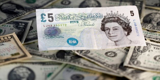 U.S. dollar and British pound notes are seen in this November 7, 2016 picture illustration. Picture taken...