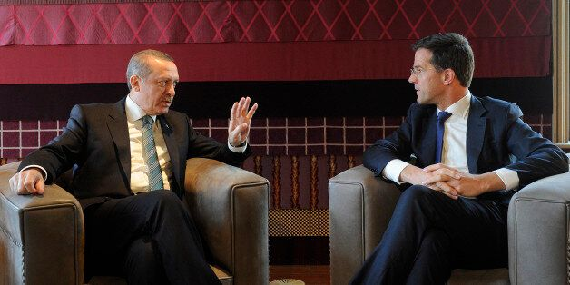 Dutch Prime Minister Mark Rutte (R) speaks with his Turkish counterpart Tayyip Erdogan at his office...