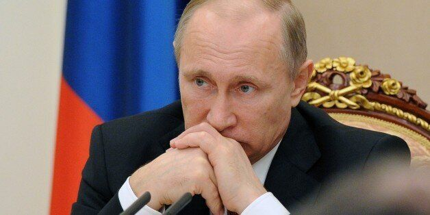 Russian President Vladimir Putin chairs a meeting with the government at the Kremlin in Moscow on March...