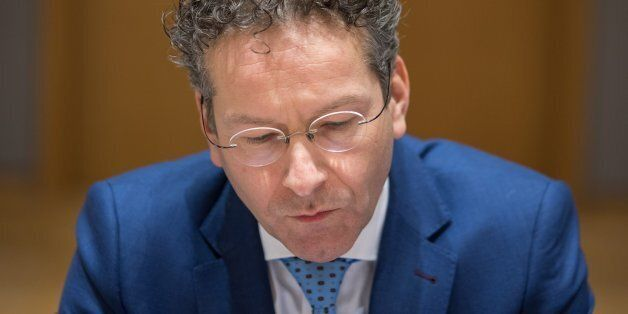 Jeroen Dijsselbloem, Dutch finance minister and head of the group of euro-area finance ministers, looks...