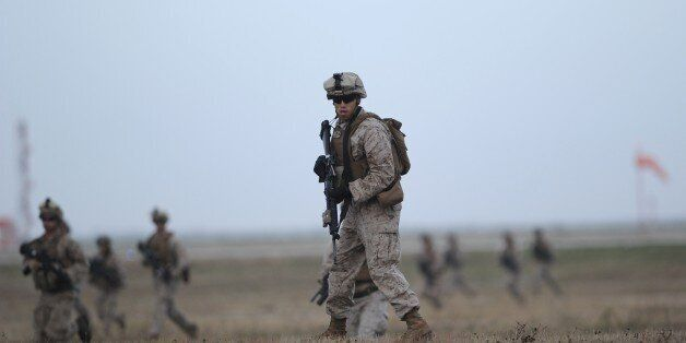 US marines perform a demonstration during the visit of US Secretary of Defense and Spanish Defence Minister...