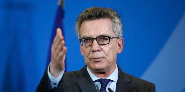German Interior Minister Thomas de Maizière attends a press conference with his new French counterpart...