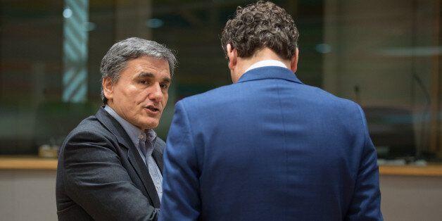 Euclid Tsakalotos, Greece's finance minister, left, speaks with Jeroen Dijsselbloem, Dutch finance minister...
