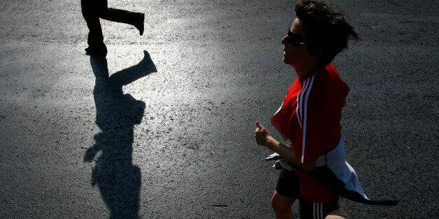 Runners participating a 10 km race run towards the finish line at Panathinaiko stadium November 9, 2008....
