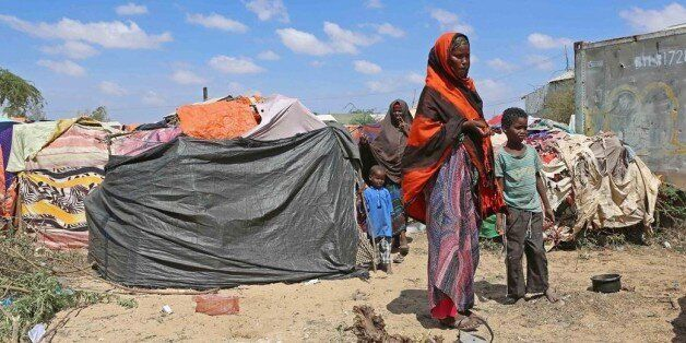 MOGADISHU, SOMALIA - MARCH 8: Somalian people try to continue their lives in tents without water and...