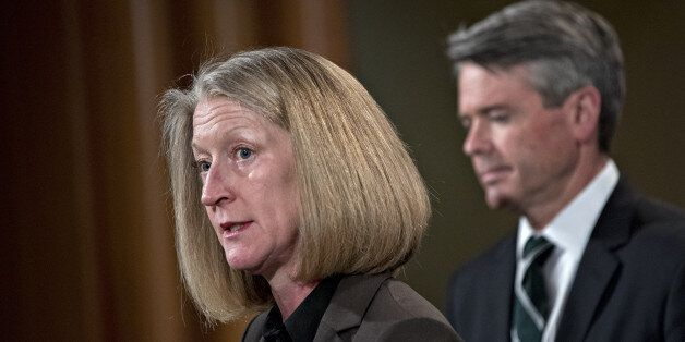 Mary McCord, acting U.S. assistant attorney general for national security, speaks as Brian Stretch, U.S....