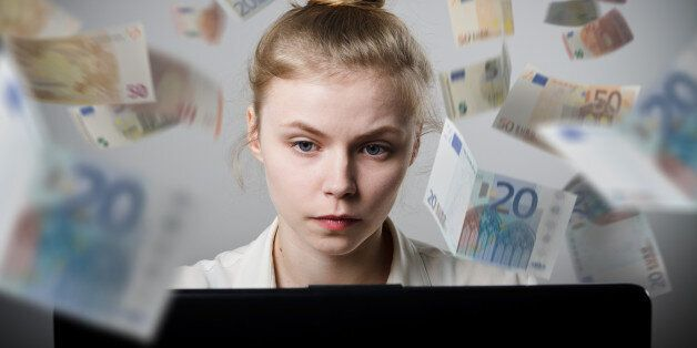 Young slim woman using a laptop to browse the net. Woman earns money on the
