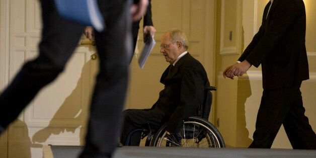 German Minister of Finance Wolfgang Schaeuble arrives to a news conference after a meeting of the Stability...