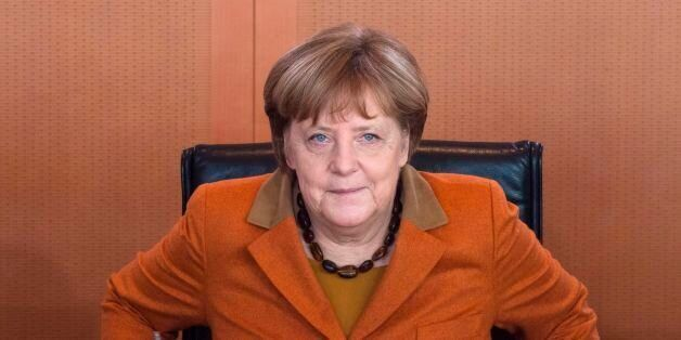 German Chancellor Angela Merkel takes her seat during a weekly meeting of the German cabinet at the chancellery...