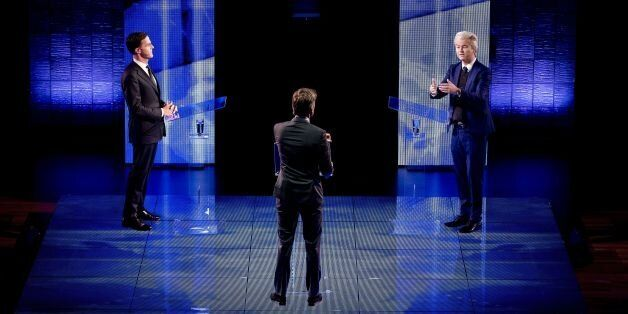 Netherlands' far-right politician Geert Wilders (R) of the PVV party gestures while during a debate with...