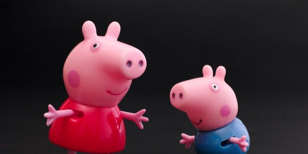 Tambov, Russian Federation - December 16, 2015: Peppa Pig and George Pig toy characters on black background....