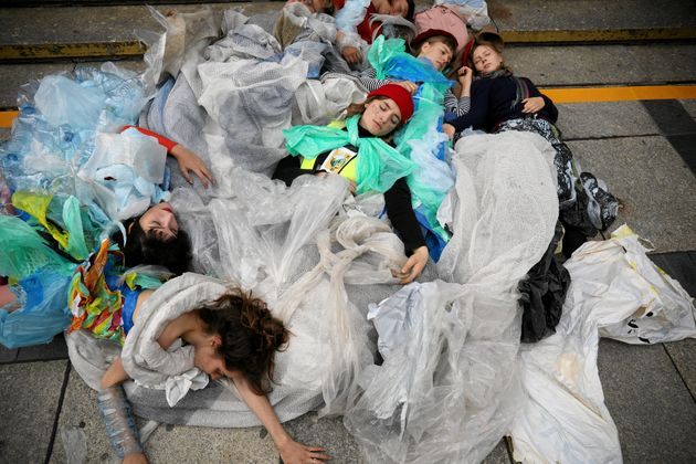 Young activists stage a performance during an environmental demonstration, part of the Global Climate...