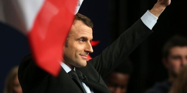 French presidential election candidate for the En Marche! movement Emmanuel Macron waves to supporters...
