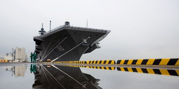 The Izumo military helicopter carrier of Japan's Maritime Self-Defense Force (MSDF) is seen moored at...