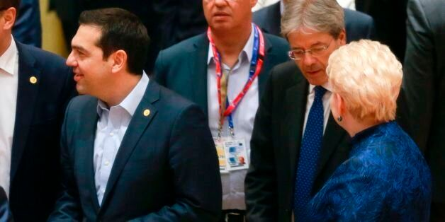 Greek Prime Minister Alexis Tsipras (L) and Italian Prime Minister Paolo Gentiloni (R) take part in the...