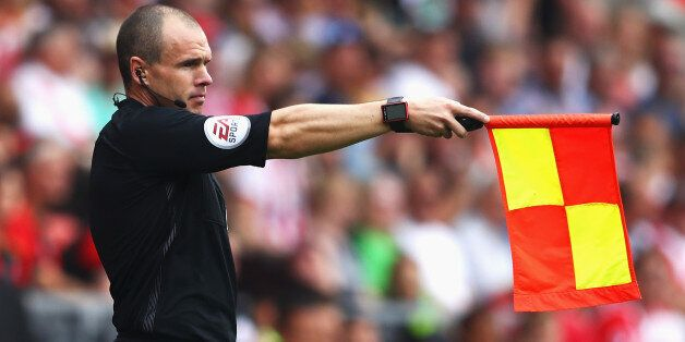 SOUTHAMPTON, ENGLAND - AUGUST 27: A assissant referee holds up the offside flag during the Premier League...
