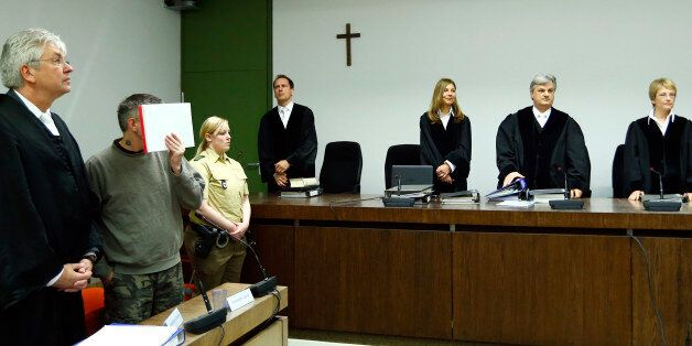 Defendant Olaf O (2nd L) of the far-right 'Oldschool Society' organisation stands next to his lawyer...