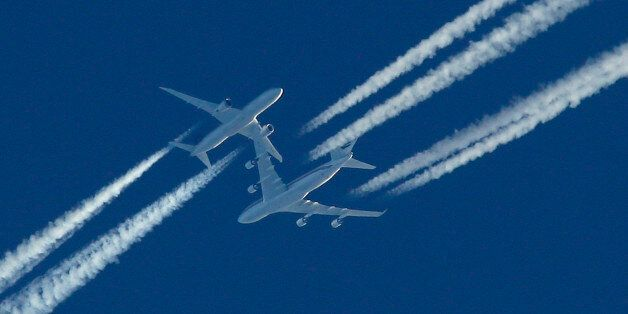 Two airliners pass in the sky above Malta as the drama of a hijacked Libyan Afriqiyah Airways Airbus...