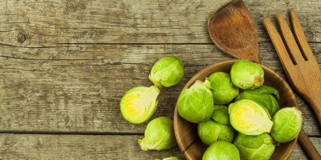 Brussels sprouts on old wooden table. Homework fresh vegetables. Growing vegetables on the farm. Preparing vegetarian food. Diet food.Brussels sprouts on old wooden table. Homework fresh vegetables. Growing vegetables on the farm. Preparing vegetarian food. Diet food.