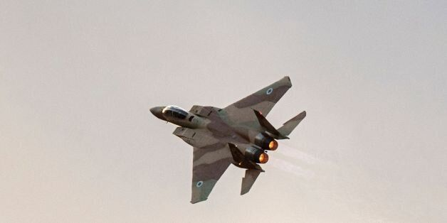 An Israeli F-15 fighter jet performs in an air show during the graduation ceremony of Israeli air force...