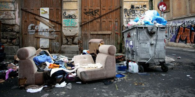 Armchairs, clothes and a broken sofa next to garbage, Athens, Greece, Oct 11, 2016 (Photo by Giorgos...