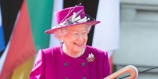 LONDON, ENGLAND - MARCH 13:  Queen Elizabeth II holds the Commonwealth baton during the launch of The Queen's Baton Relay for the XXI Commonwealth Games being held on the Gold Coast in 2018 at Buckingham Palace on March 13, 2017 in London, England.  (Photo by Samir Hussein/Samir Hussein/WireImage)