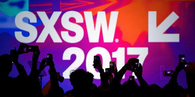 Attendees use hand held phones to take photographs at the 2017 South By Southwest (SXSW) Interactive...