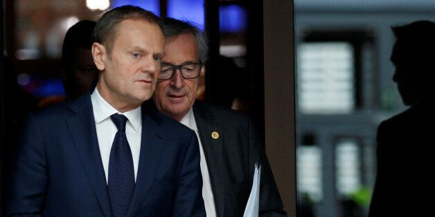 European Council President Donald Tusk (L) and European Commission President Jean-Claude Juncker arrive...