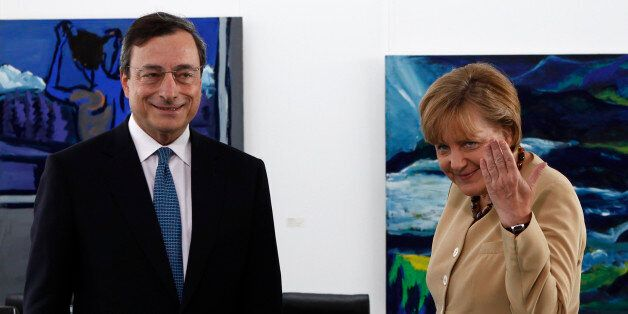 German Chancellor Angela Merkel (R) and Bank of Italy Governor and candidate for European Central Bank...