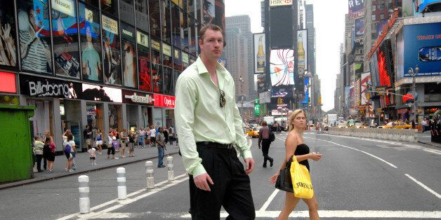 UNITED STATES - AUGUST 05: Neil Fingleton, the tallest man in the world at 7' 7.5' strolls through Times Square and meets tourists and New Yorkers who are asking for his autograph. (Photo by David Handschuh/NY Daily News Archive via Getty Images)