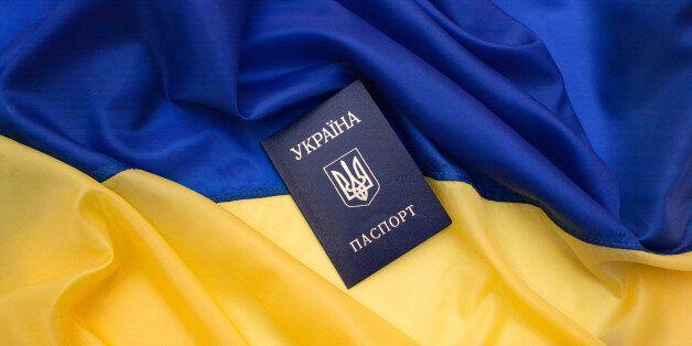 Ukrainian passport on the flag of