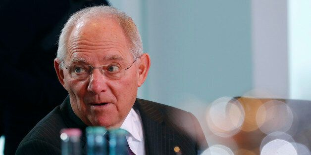German Finance Minister Wolfgang Schaeuble attends the weekly cabinet meeting at the Chancellery in Berlin,...