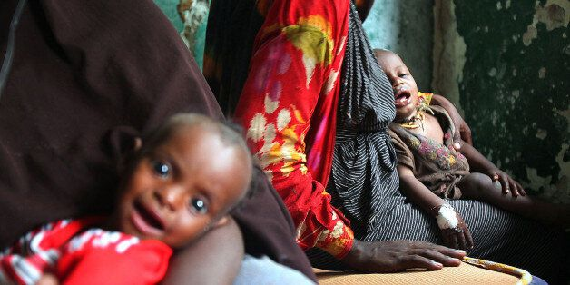 SOMALIA - AUGUST 2: (SOUTH AFRICA OUT) Somalian parents with their sick children at the Gift of Givers...