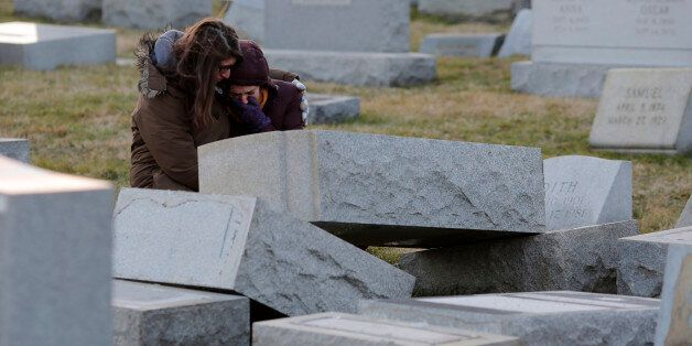 Melanie Steinhardt comforts Becca Richman at the Jewish Mount Carmel Cemetery, February 26, 2017, in...